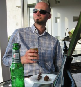 Enjoying some complimentary beer and chocolate at the Amsterdam Hilton's executive lounge