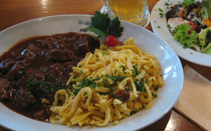 """Hey! This Gulasch mit Spätzle had TWO sprigs of parsley garnish in the menu picture. Take it back."""