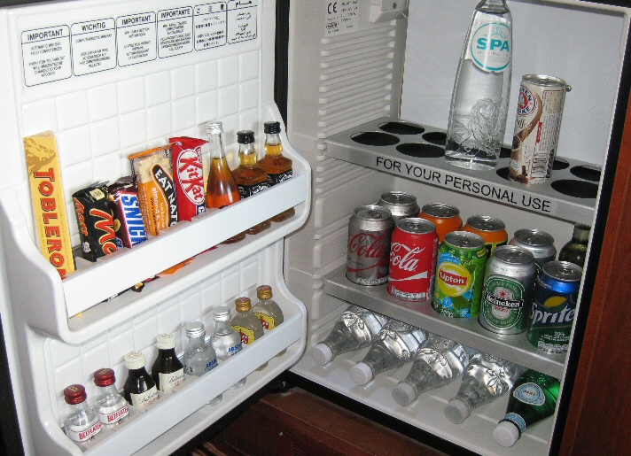 The top shelf was the only usable space for personal items in the minibar fridge. The other items were automatically charged to the room upon removal. Be careful!